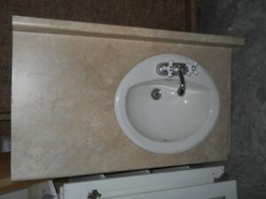Bathroom sink taps and top