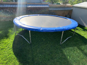 Trampoline for sale, hardly been used, great condition