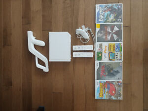 Nintendo Wii, 2 controllers, 1 nunchuck controller, and 5 games