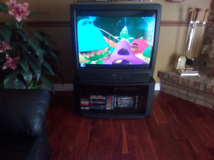 JVC Television with stand.