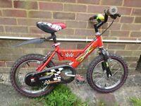 Child's red raleigh bike