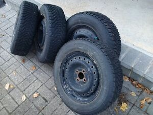 Four Goodyear Nordic snow tires on steel rims 185/65R15