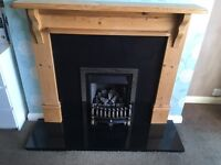 Gas fire, granite hearth and wooden surround