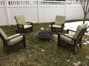 Four patio chairs and a fire pit