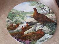 7 collectable plates of wild birds, $25.00 each. 2 plates of dif