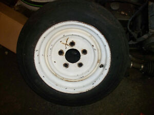 12 inch trailer tire on 5 bolt rim , as new  only one left