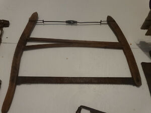 Vintage crosscut blade saw with wooden handles