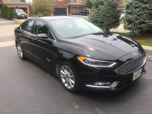 2017 Ford Fusion Energi Hybrid.  Leather NAV 950Kms per tank!