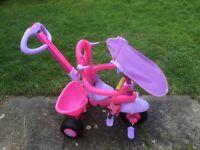 Childs pink stroller