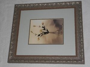 gold tan frame with flower in vase