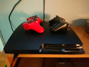 Playstation 3 bundle comes with 2 controllers and 14 games