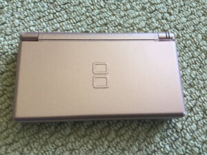 Nintendo DS with charger and 60 Games
