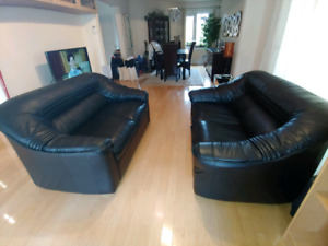 Two all leather black loveseats.  Smoke free, pet free home.