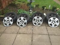 "Vauxhall insignia steel 17"" wheels with tyres 3/4 MM tread and wheel covers."