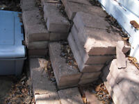 many LARGE red stippled on one side cement blocks