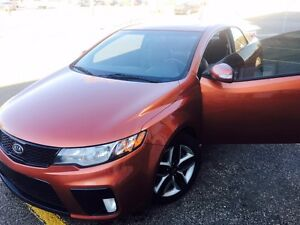 2010  Bright Orange Kia Forte Koup