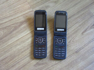 Two LG -A341 Cell Phones + One Case with UNLOCK Codes