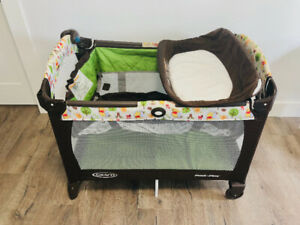 Graco Pack n Play travel crib with a changing table/bassinet.