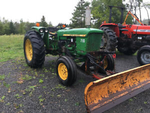 1-710 John Deere tractor with Power angle snow blade