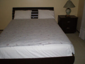 Queen bed, end table and lamp