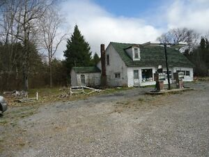 COMMERCIAL GARAGE WITH 1ACRE LOT