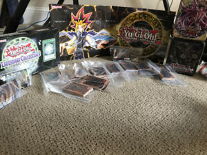 *Over 300* Yu-Gi-Oh Cards including tins and game board