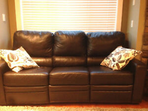 Near New Reclining Leather Sofa and Love Seat Set