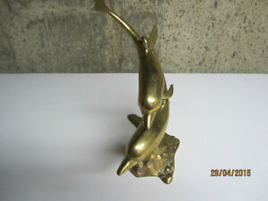 Brass Dolphin ornament.