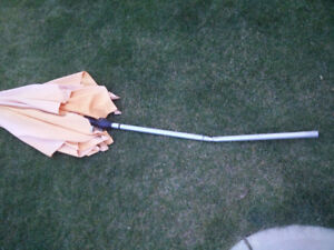 Patio umbrella, damaged but could be repaired with a pipe sleeve