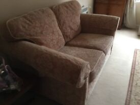 Two identical sofa,s.
