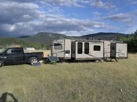 Need place to park my new 30' trailer to live in on private land