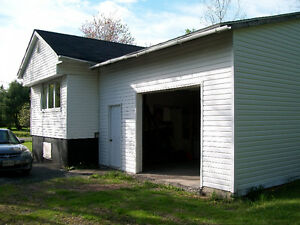 2-3 Bedroom Mini / Mobile Home with basement and attached garage