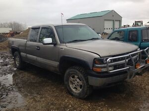 2001 Chevy silver Silverado four-wheel-drive 1500