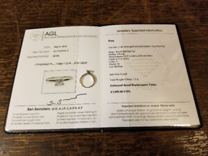 Lady's 14k White Gold Diamond Solitaire Ring $275