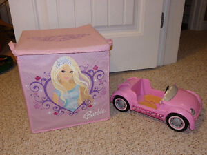 Barbie dolls, clothes, accessories, storage box, and sports car
