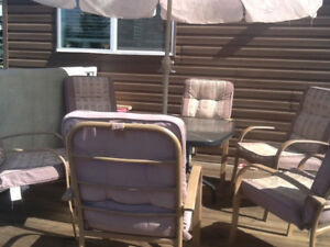 6 patio chairs.very nice condition ,table  and Umbrella +stand.