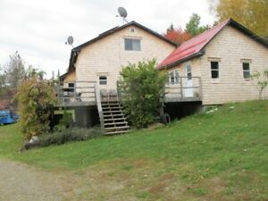 Net metered lodge style home in Glassville New Brunswick 97 acre
