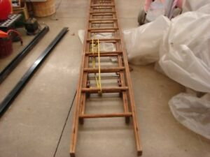 A WOODEN EXTENSION LADDER ANTIQUE GREAT FOR USE OR DISPLAY