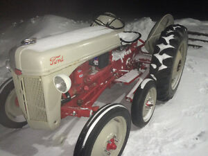 Ford 8n tractor with tracks