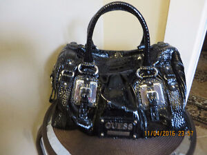 guess purses black color   in excellent condition $ 60
