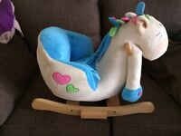 Rocking horse sit in with sounds