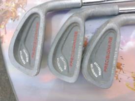 Precisionaire golf clubs x 7 . . Regular flex