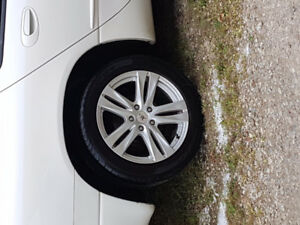 Like new CTX 17 inch alloy rims with like new 215/55R17 tires
