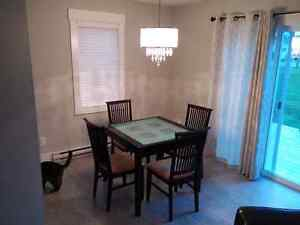 Glass top table and 4 chairs.