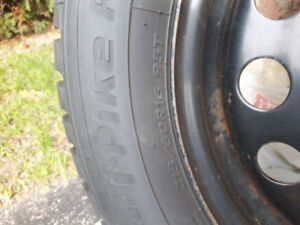 Set of 4 barly used winter tires of a 2014 chevy cruze ltz.