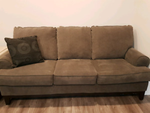 Recently purchased dark grey couch