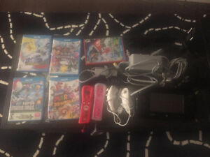Wii U Package w/ 2 remotes, 2 nunchucks and 5 games