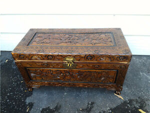 Wooden chest with carving