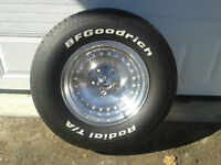 5  American race rims with tires.
