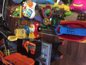 Various baby toys , strollers, swings and bouncers
